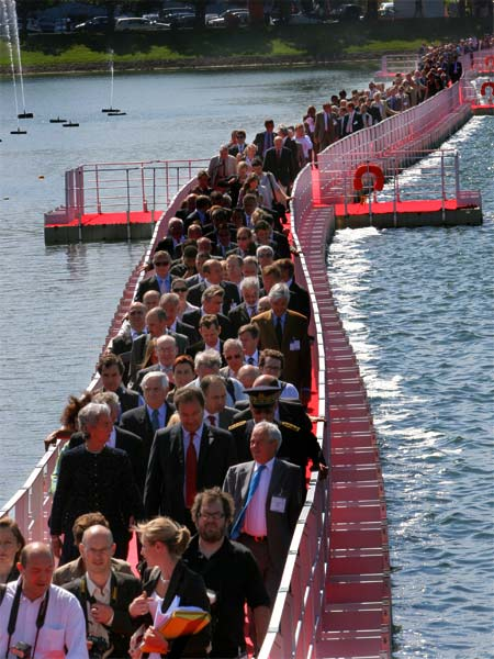 hundreds of people waking across a half mile walkway constructed of EZ Docks